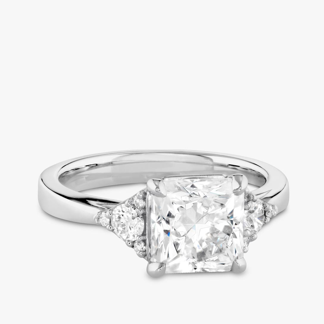 Sidestone diamond engagement ring
